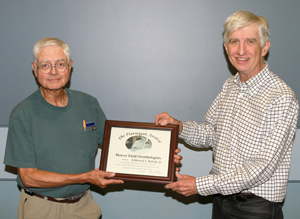 Ed Holub receives 2016 award from President Joe Roller. Photo by Will Burt.